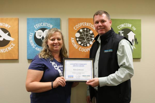 Kim Johnson receives the Live Better Award from Nate Boettcher, president and CEO